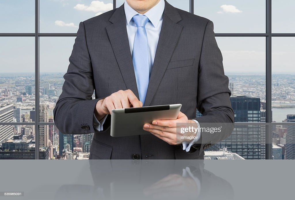 businessman with touch pad : Stock Photo