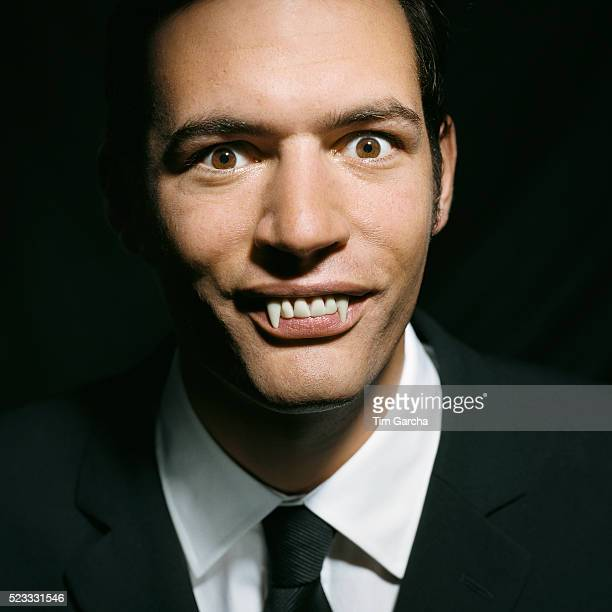 Businessman with Vampire Teeth
