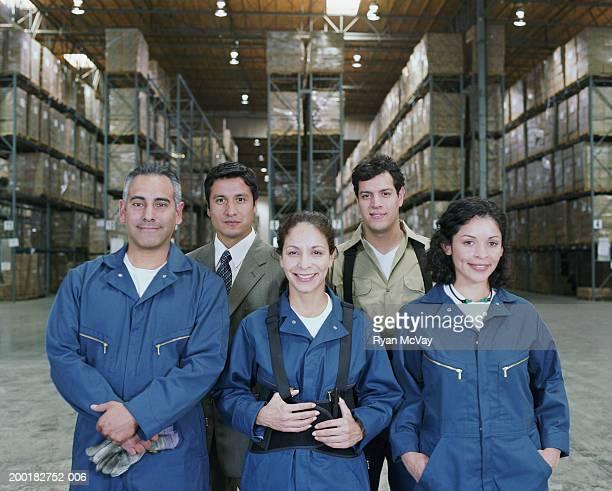 Businessman with warehouse staff, portrait