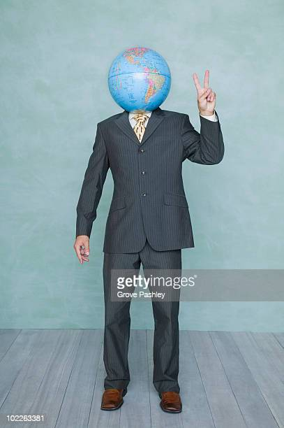 businessman with world globe as his head - gesturing stock pictures, royalty-free photos & images