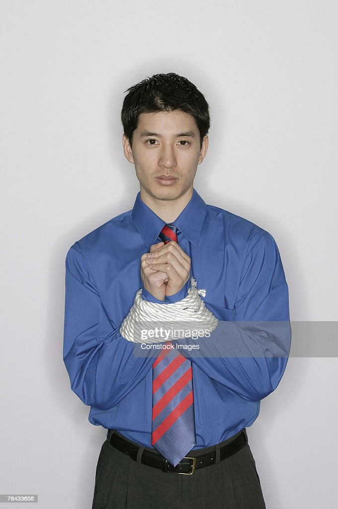 Businessman with wrists tied : Stockfoto