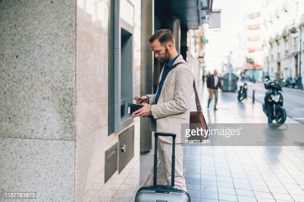 businessman withdrawing money - bank financial building stock pictures, royalty-free photos & images