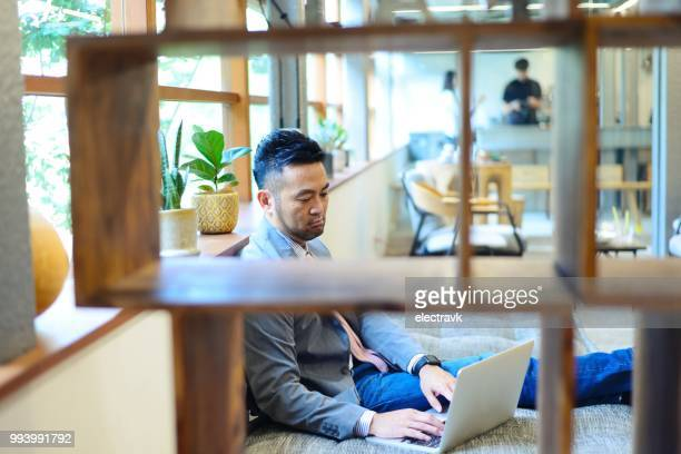 businessman working at a cafe - coworking stock photos and pictures
