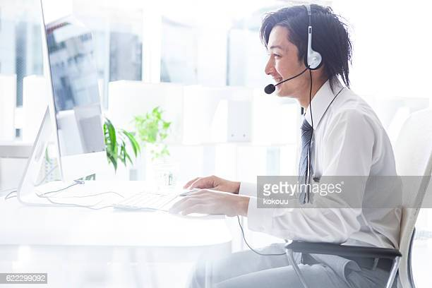 Businessman working at a call center