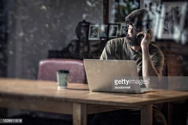 Businessman Working at a Coffee Shop on his Laptop