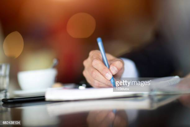 Businessman working at cafe
