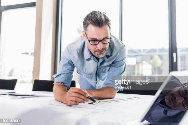 businessman working at desk in office - concentration stock pictures, royalty-free photos & images