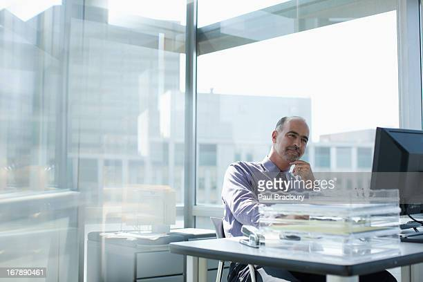 businessman working at desk - formal businesswear stock pictures, royalty-free photos & images