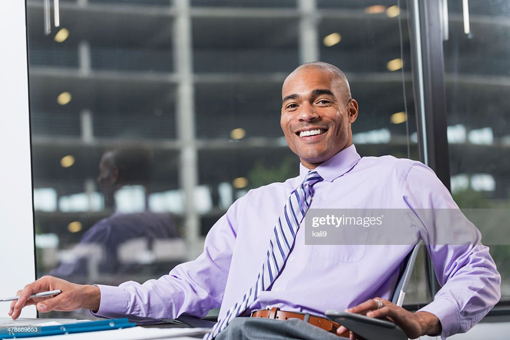 Businessman working at desk : Stock Photo