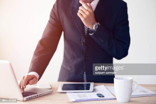 Businessman working at office with laptop and tablet