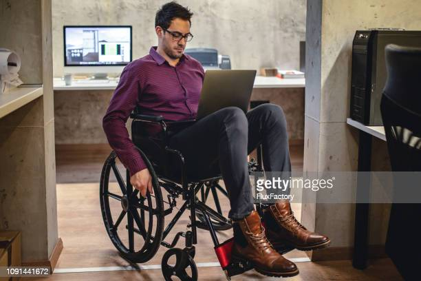 businessman working from his wheelchair - disabled access stock photos and pictures