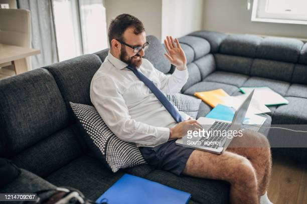 businessman working from home do to pandemic outbreak - small stock pictures, royalty-free photos & images