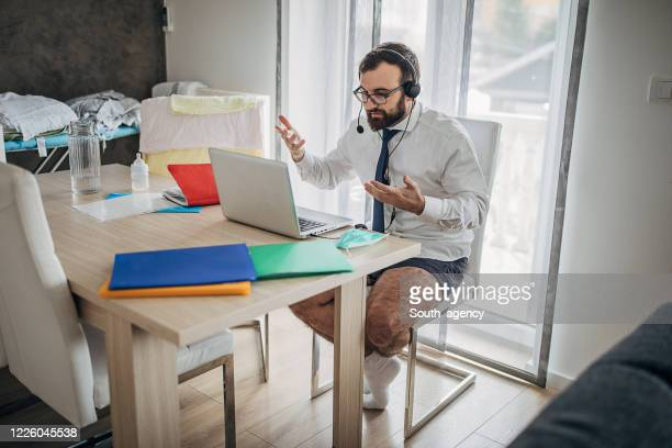 businessman working from home do to pandemic outbreak - shorts stock pictures, royalty-free photos & images