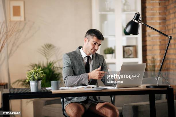 businessman working from home do to pandemic outbreak stock photo - shorts stock pictures, royalty-free photos & images