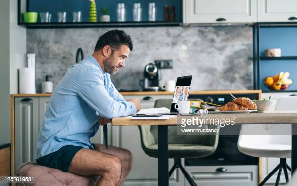 businessman working from home during pandemic outbreak covid-19 - small stock pictures, royalty-free photos & images