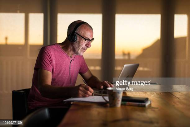 businessman working from home on laptop during lockdown - video conference stock pictures, royalty-free photos & images