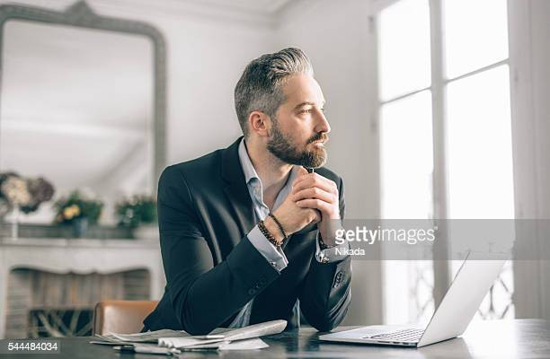 businessman working from home - staring stock photos and pictures