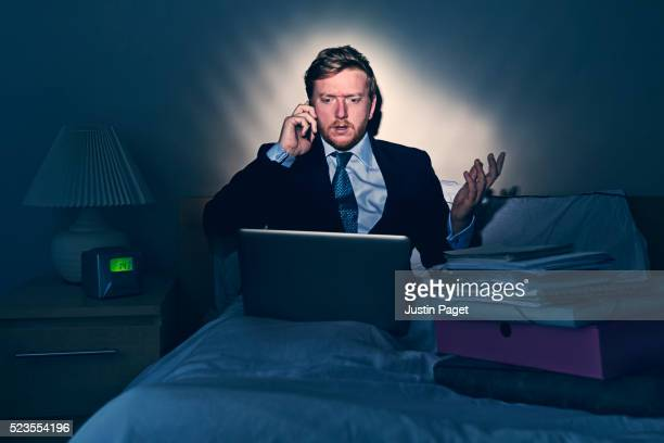 Businessman Working in Bed