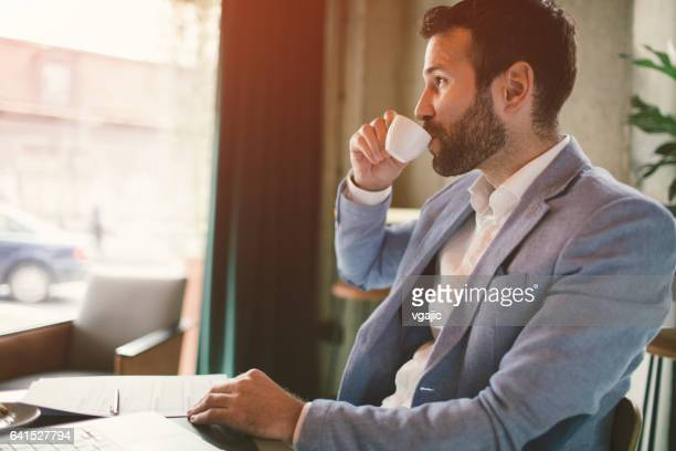 businessman working in cafe - espresso stock photos and pictures