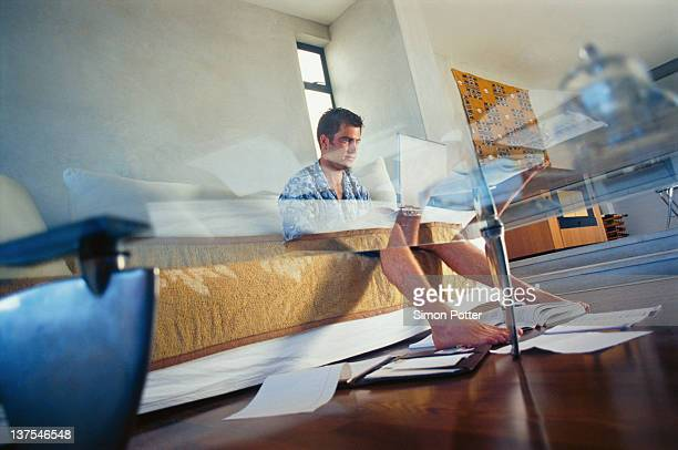Businessman working in living room