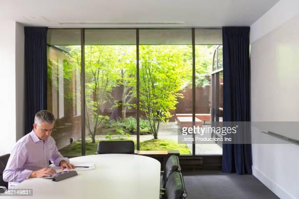 Businessman working in meeting room
