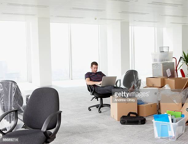 Businessman working in new office