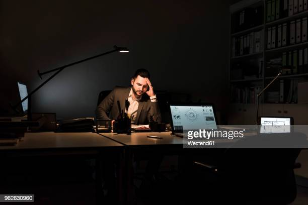 Businessman working in office at night