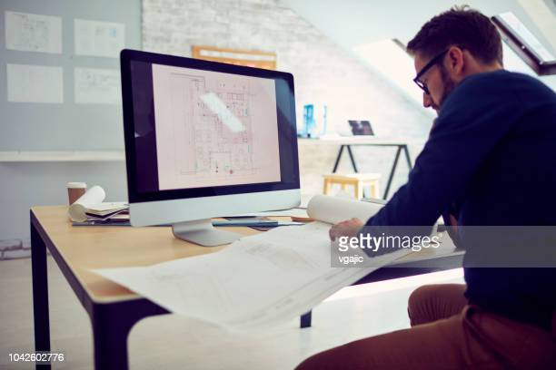 businessman working in office - architect stock pictures, royalty-free photos & images