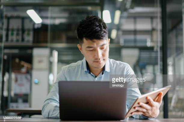 businessman working in office - asia stock pictures, royalty-free photos & images