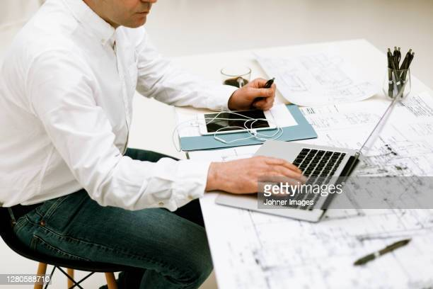businessman working in office - human body part stock pictures, royalty-free photos & images