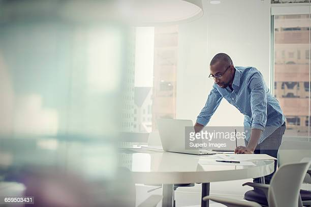 businessman working in office - rolled up sleeves stock pictures, royalty-free photos & images