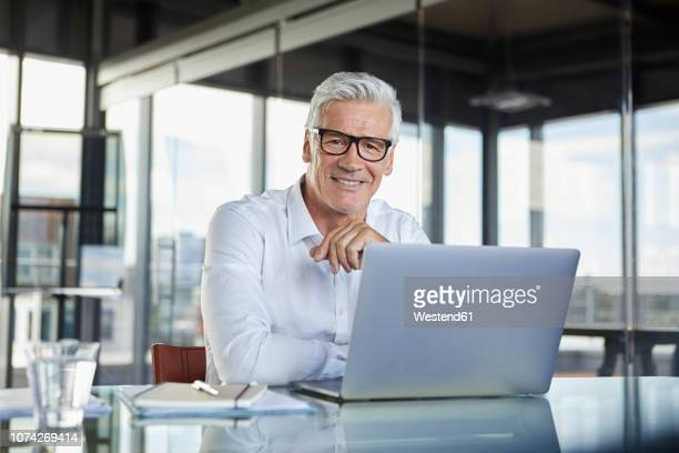 businessman working in office, using laptop - white hair stock pictures, royalty-free photos & images
