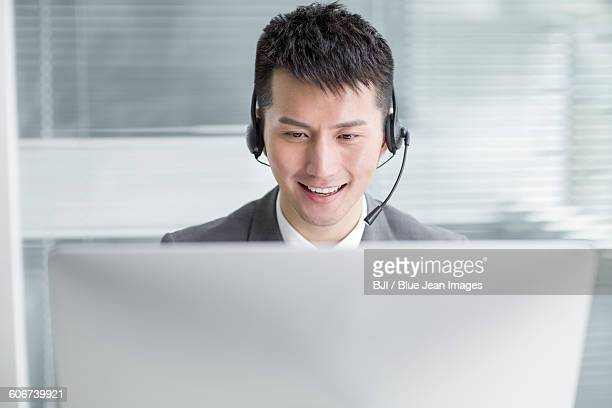 Businessman working in office with headset