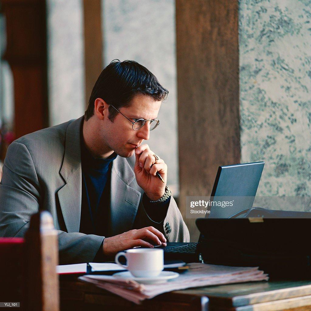 Businessman working in restaurant : Stock Photo