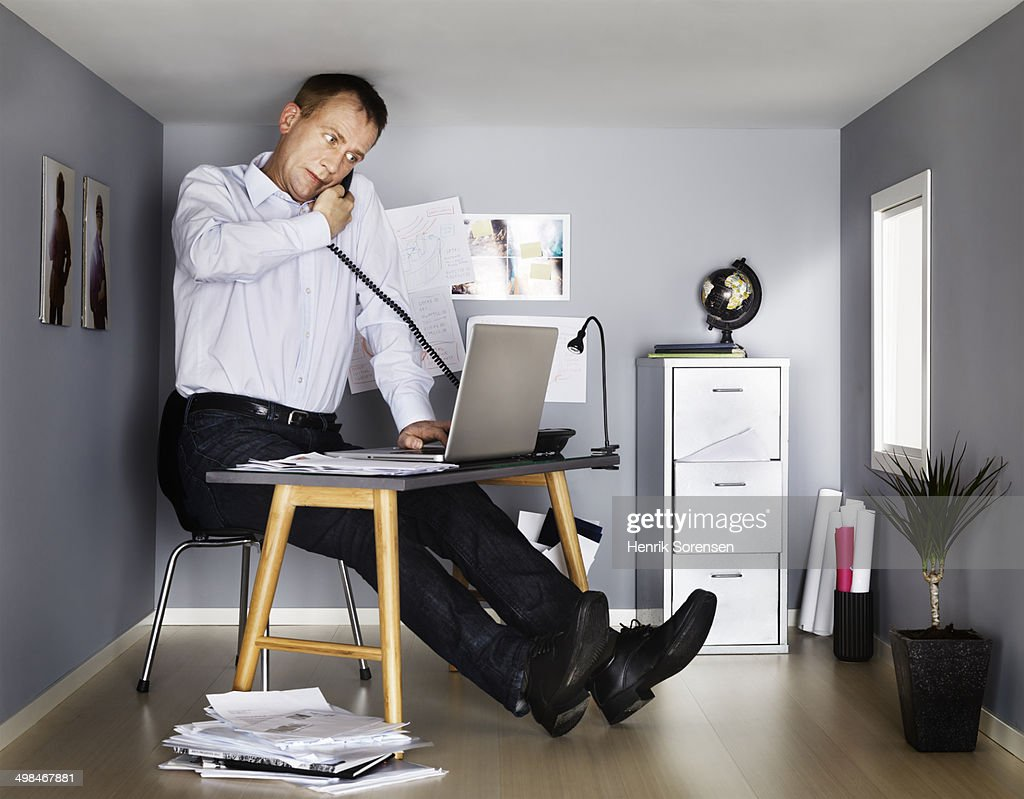 Businessman working in small office stock photo getty images for Office images