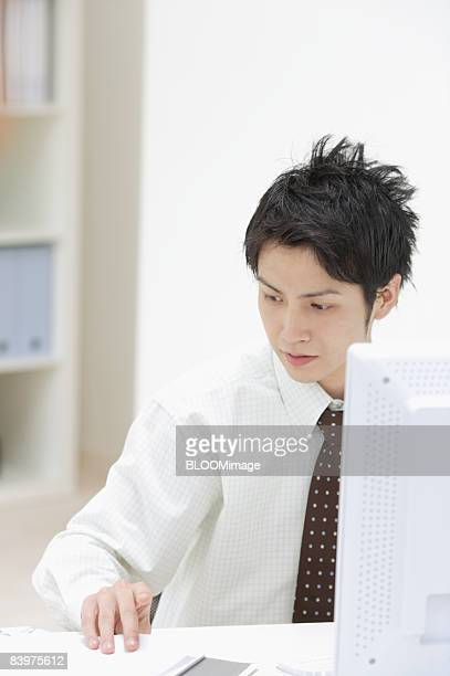 Businessman working in small office