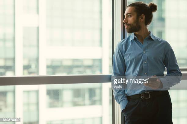 businessman working in the office - man bun stock pictures, royalty-free photos & images