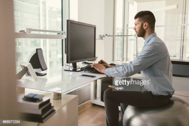 businessman working in the office - fitness ball stock pictures, royalty-free photos & images