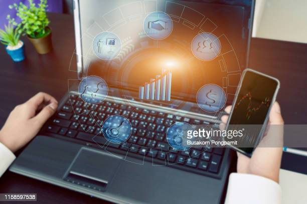 businessman working investment project modern office. worldwide connection technology,stock exchanges graphics interface. horizontal - data stream - fotografias e filmes do acervo