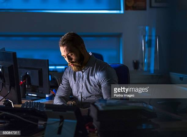 Businessman working late at computer desk