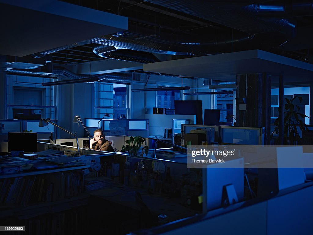 Businessman working late at desk in office : Stock Photo