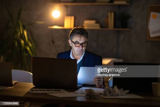 businessman working late at night to get the job done - financial analyst stock pictures, royalty-free photos & images