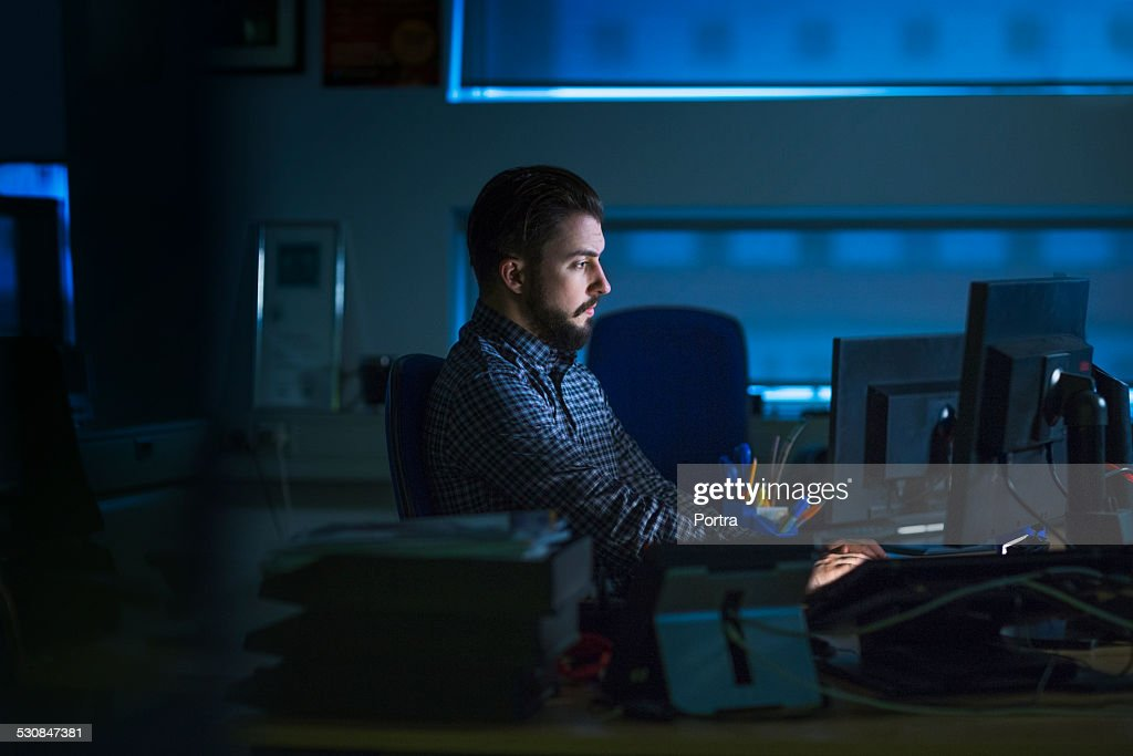 Businessman working late in office : Stock Photo
