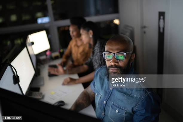 businessman working late in the office - small group of people stock pictures, royalty-free photos & images