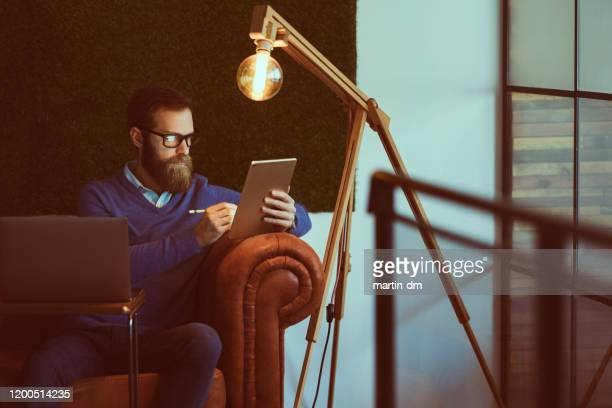 businessman working late in the office - martin dm stock pictures, royalty-free photos & images