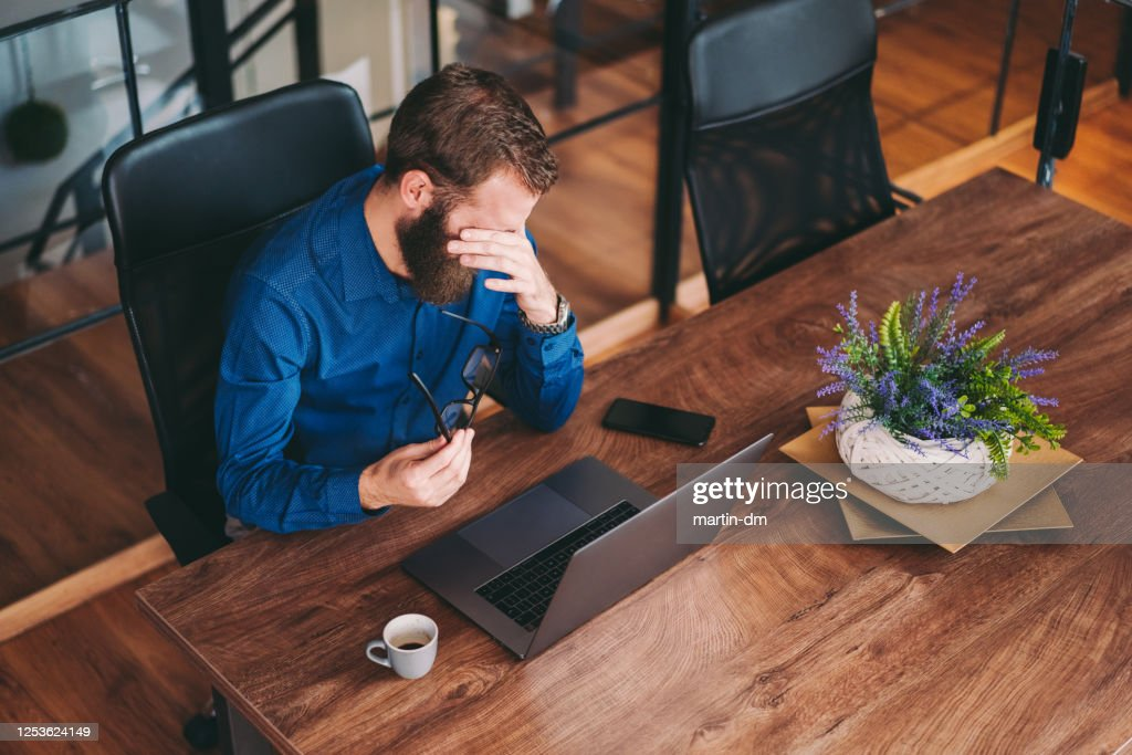 Businessman working late in the office : Stock Photo