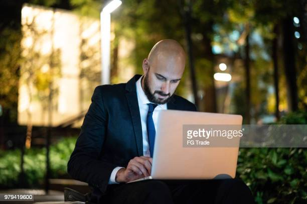 Businessman Working Late on Laptop