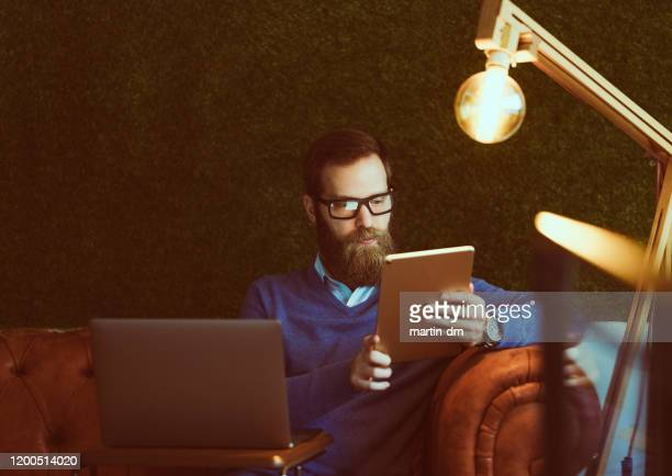 businessman working late - martin dm stock pictures, royalty-free photos & images