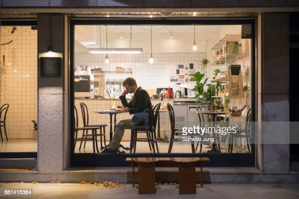 businessman working latein cafe - one man only stock pictures, royalty-free photos & images