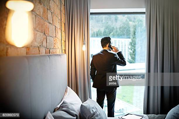Businessman working on a business trip at the hotel room